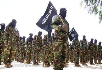 Al Shabaab fighters with their flag