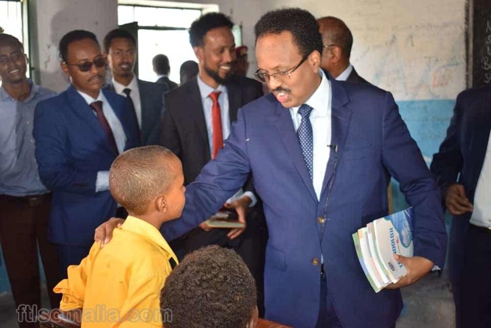 President Farmajo of Somalia providing books to school